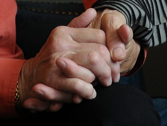 GWM File Photo holding hands