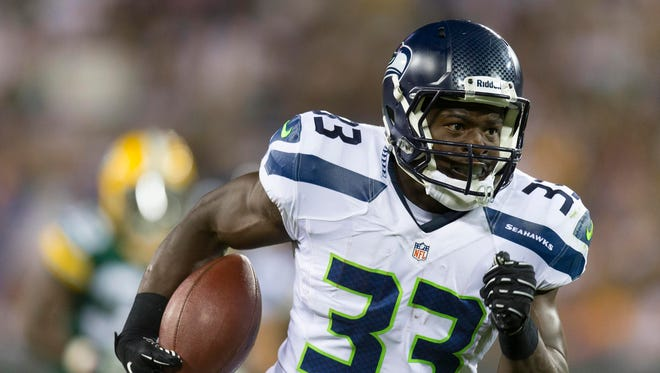 Seattle Seahawks running back Christine Michael (33) rushes for a touchdown during the third quarter against the Green Bay Packers at Lambeau Field.