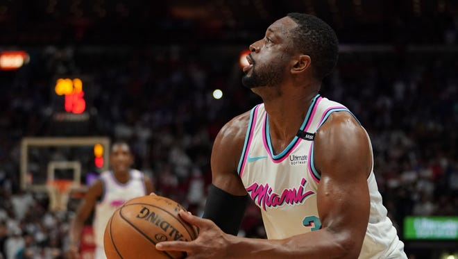 Feb 27, 2018; Miami, FL, USA; Miami Heat guard Dwyane Wade (3) shoots the ball against the Philadelphia 76ers during the second half at American Airlines Arena. Mandatory Credit: Jasen Vinlove-USA TODAY Sports