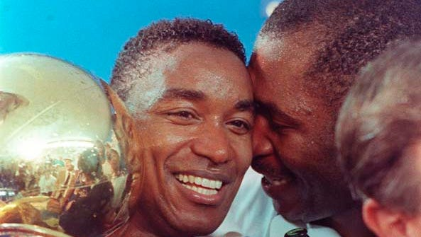 The Pistons won their first NBA championship by defeating the Lakers on June 13, 1989. Isiah Thomas, left, hugs the Larry O'Brien trophy in the locker room at The Forum in Los Angeles.