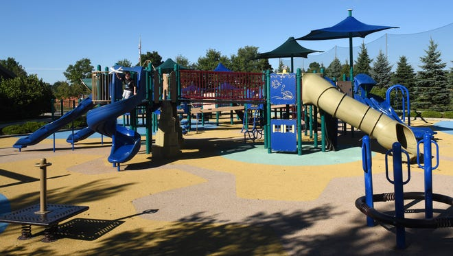 Robert McConnell, 6, plays on the playground at Rotary Park in Newark. The playground will close the week of Sept. 25 as new surfacing is put in place and maintenance is done.