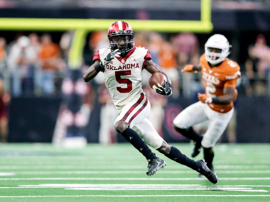 Dec 1, 2018; Arlington, TX, USA; Oklahoma Sooners wide receiver Marquise Brown (5) runs during the game against the Texas Longhorns in the Big 12 Championship game at AT&T Stadium. Mandatory Credit: Kevin Jairaj-USA TODAY Sports
