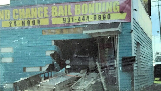 The back of the truck and the trailer, which crashed into Second Chance Bail Bonding on Providence Boulevard.