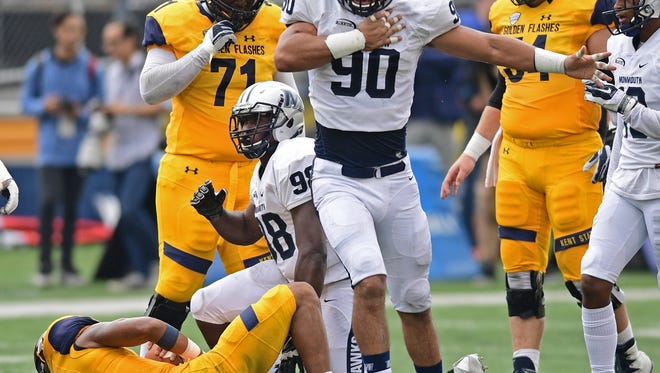 Monmouth University's Manny Maragoto (90) celebrates a sack during the Hawks' 27-7 loss at Kent State. Monmouth's home-opener is Saturday afternoon against Charleston Southern