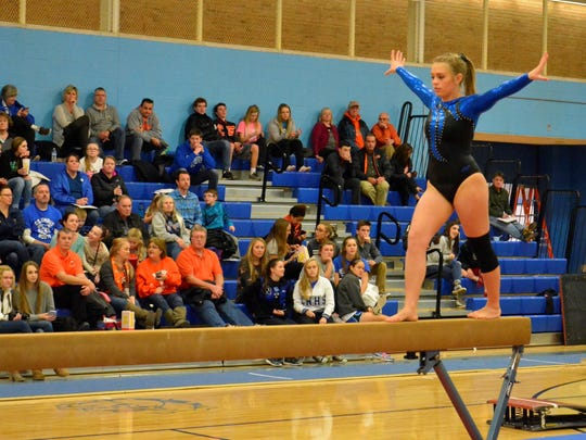 Columbus North's Ashley Holliday takes her turn on the vault.