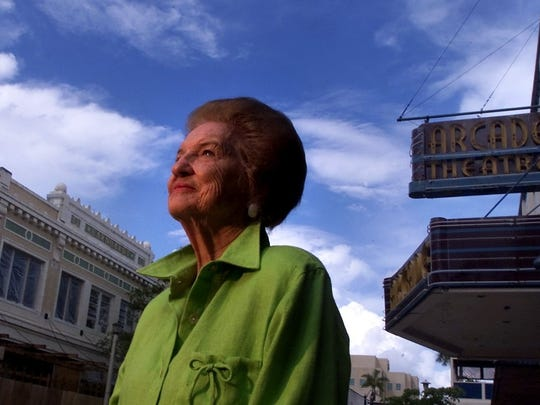 Berne Davis, a long time Fort Myers resident witnessed many changes to downtown Fort Myers since she moved here in 1928. Here she stands at the base of the Arcade Theatre where her husband, Sidney Davis owned a menswear shop next door.