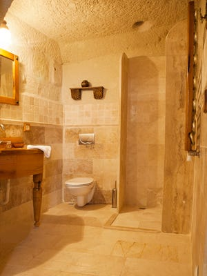 If you can find a way to squeeze a shower into your home's existing half bath, thereby upgrading it into a full bath, that will add more value to your home than updating the kitchen, says Realtor Monte Mohr.