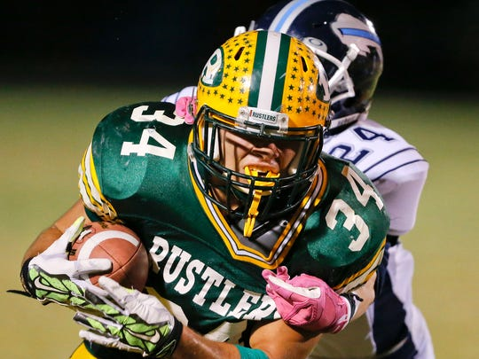 C.M. Russell High halfback Andrew Grinde.