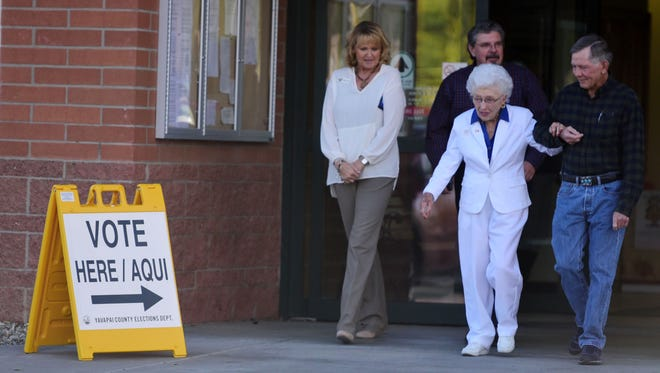Jerry Emmett, who was born before all women won the right to vote in the U.S., leaves the Yavapai County Administration Building on Nov. 1 after casting her early ballot.