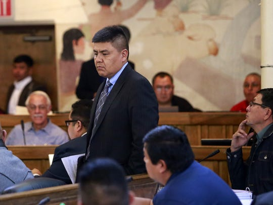 Navajo Nation Delegate Jonathan Hale returns to his seat during the winter council session in January in Window Rock, Ariz. Last week, Hale sponsored a tribal bill that supports federal legislation that would strengthen a law banning the export of Native American sacred and traditional items.