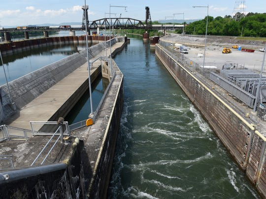 Water drains out of the lock before a set of doors open at the Chickamauga Dam on Monday, Apr. 25, 2016, in Chattanooga, Tenn. Work is underway to build a new and bigger lock for barge and recreational boat traffic.