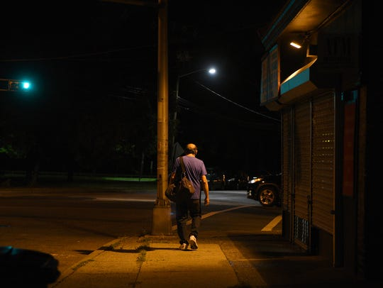 Edgar Acosta walks down Clifton Avenue at 4:15 a.m.