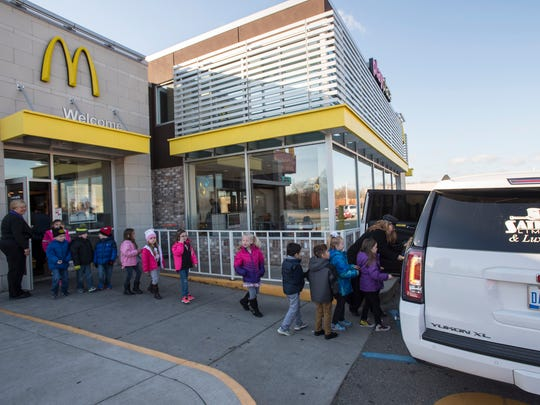 A group of Keewahdin Elementary students are lead out of McDonald's in Fort Gratiot Township and into a limousine Wednesday. Students who raised $150 or more as part of the school's Husky Hustle fundraiser were given a ride in a limo to McDonald's and Lakeside Beach.