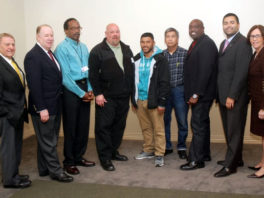 Union County Freeholder Vice Chairman Sergio Granados joined Elizabeth Mayor J. Christian Bollwage, Union County College President Margaret McMenamin and Victor Richel, Chairman of the Board of Trustees of Union County College, in congratulating Obadiah Dryer, Claudio Argemi, David Guevara, Kun Yu Chou and Dexter Vally who recently graduated from the Metal Fabrication/CNC Machinist training program for high-tech jobs in advanced manufacturing during a ceremony in Elizabeth.