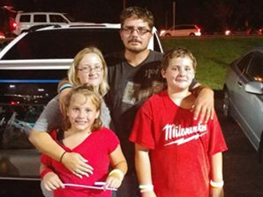 David Scullion and his wife Melissa along with their 9-year-old daughter and 11-year-old son.