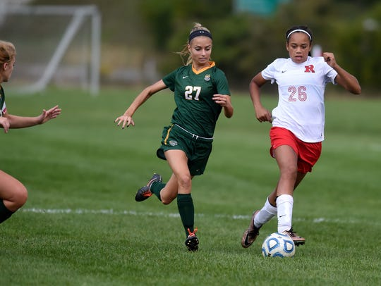 Richmond's Nakala Bennett moves the ball against Floyd