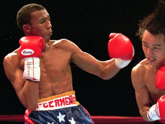 FILE - In this Dec. 21, 1996 file photo, Venezuela's Antonio Cermeno, left, fights Japan's Yuichi Kasai in a WBA Junior Featherweight Championship bout in Las Vegas. Cermeno, a WBA super bantamweight and featherweight champion in the 1990's, was kidnapped on Monday, Feb. 24, 2014 in Caracas, Venezuela and found shot to death the next day, police said. (AP Photo/Jim Laurie, File)