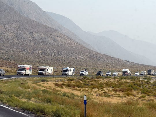Trevor Hughes/USA TODAY A long line of cars, trucks and RVs snakes around a while leaving the Burning Man encampment area on Monday during the departure event known as Exodus. A long line of cars, trucks and RVs snakes around a while leaving the Burning Man encampment area on Sept. 4, 2017 during the departure event known as Exodus.