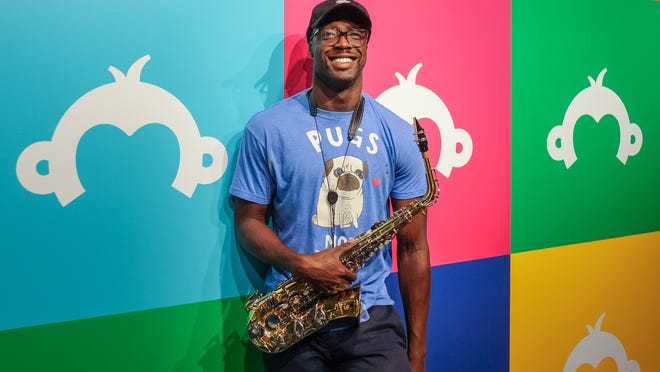 Jabari Lateef with his sax at SurveyMonkey HQ.