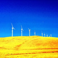 Wind turbines stand tall on the hills of Altamont Pass in Altamont, Calif.