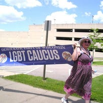 Jamie Shiner marches in downtown Wausau with other members of the LGBT Caucus of Wisconsin Democrats.