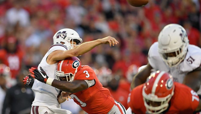 Sep 23, 2017; Athens, GA, USA; Mississippi State Bulldogs quarterback Nick Fitzgerald (7) is hit as he throws by Georgia Bulldogs linebacker Roquan Smith (3) during the first quarter at Sanford Stadium. Mandatory Credit: Dale Zanine-USA TODAY Sports
