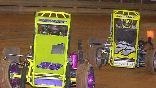 Brendon Bright, left, leads his brother Alex (77) in the early stages of the ARDC Midgets race at Clyde Martin Memorial Speedway on Saturday. Alex Bright captured the season-opining win.
