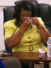 Sandra Harrison wipes her eyes after testifying during a human relations commission hearing in York. Harrison was one of five black women who were playing golf in April when police were called by the Grandview Golf Course for alleged slow play.