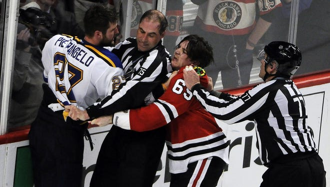 Blackhawks center Andrew Shaw and Blues defenseman Alex Pietrangelo are separated near the end of Game 4.