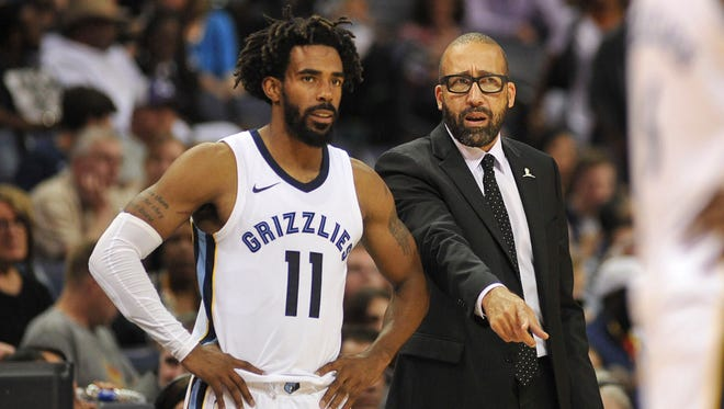 Memphis Grizzlies guard Mike Conley (11) and head coach David Fizdale during the first half against the New Orleans Pelicans at FedExForum.