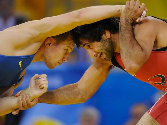 Team USA's Mike Zadick, right, competes against Ukraine's Vasyl Fedoryshyn in the men's freestyle wrestling 60 kilogram class at the Beijing 2008 Olympic Games.
