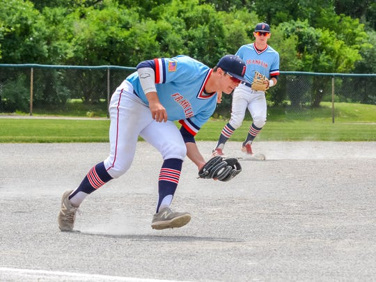 Coming in to grab a hopper is Livonia Franklin's Harrison Merrill. He later had a key RBI single against Churchill.