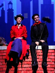 Kirsten Larson, playing Mary Poppins, sits with Grant Petik during a dress rehearsal at the Fond du Lac High School P.A.C.