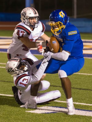 Germantown's Jacob Mangino (47) and Nigel Knott (13) try to stop Oxford's DK Metcalf in Friday's playoff game.