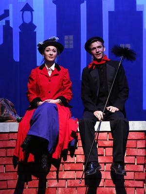 Kirsten Larson, playing Mary Poppins, sits with Grant Petik during a dress rehearsal at the Fond du Lac High School.