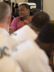Renea Tate of Chesapeake, Va., whose daughter died, speaks to inmates at the Sussex Correctional Institution to help them understand the impact of crime on victims.