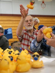 Dennis Crisman tosses a duck toward that's been prepared for Sunday's Great Kitsap Duck Race. The Silverdale Rotary's biggest fundraiser of the year, the Duck Race takes place Sunday during the Whaling Days festival.