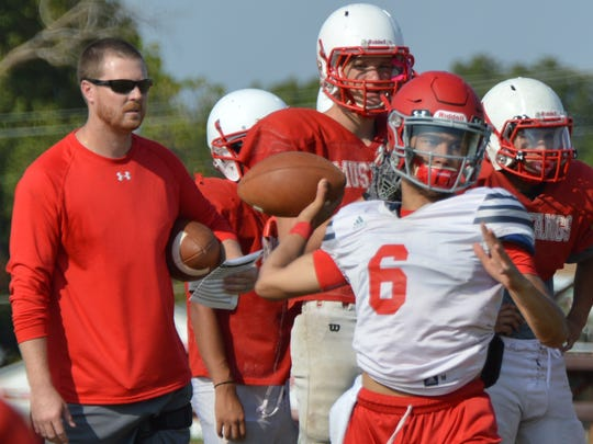 Sweetwater senior quarterback Chris Thompson, shown here throwing a pass during practice on Tuesday, has quickly adjusted to the new offensive scheme implemented by first-year coach Ben McGehee (far left).