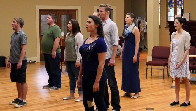 """The cast of """"The Man of La Mancha"""" rehearses the score to the historic musical on July 2."""
