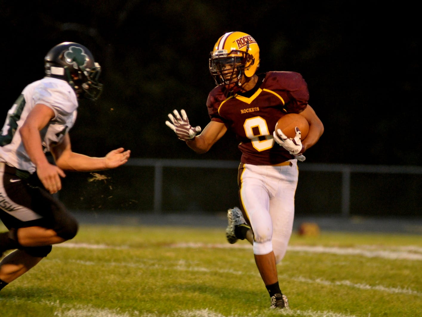 Berne Union's Bishop Reese tries to evade Fisher Catholic's Allen McCall during Friday night's game in Sugar Grove. The Irish defeated the Rockets 10-7.