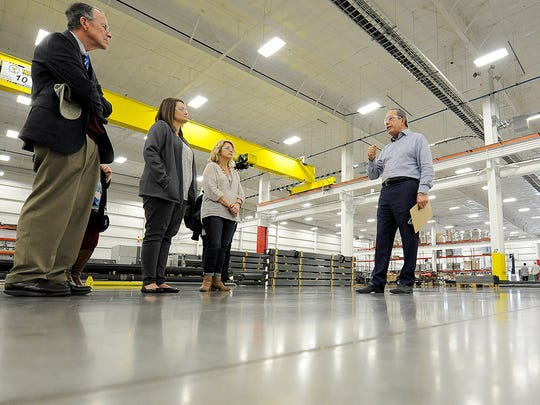 Made In America Seating CEO Darius Mir (right) leads a tour of his factory in Union City on Tuesday.