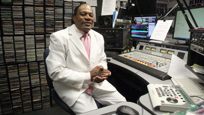 DJ Ron Richard is pictured in his booth at the KNEK 104.7 studio Saturday in Lafayette.