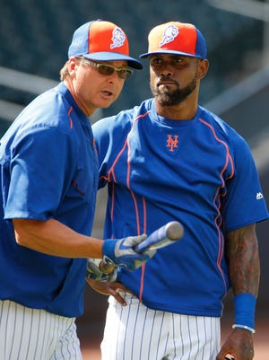 The Mets announced that Tim Teufel, here with Jose Reyes, will serve as a roving minor league infield instructor and club ambassador. (AP Photo/Kathy Willens)