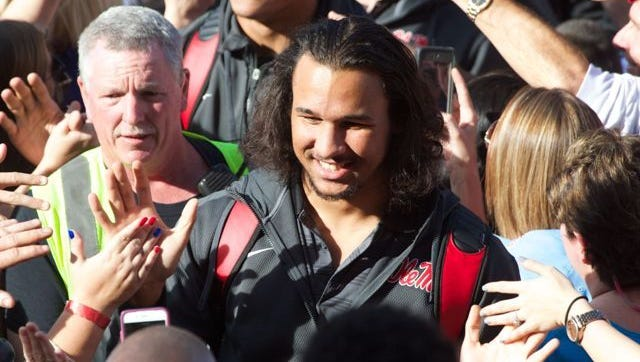 Ole Miss defensive leader Cody Prewitt greets fans during the walk of Champions.
