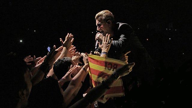 Bono and U2 perform at Palau Saint Jordi in Spain.