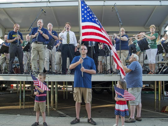 Concert organizer John Stewart, a baritone, sings the