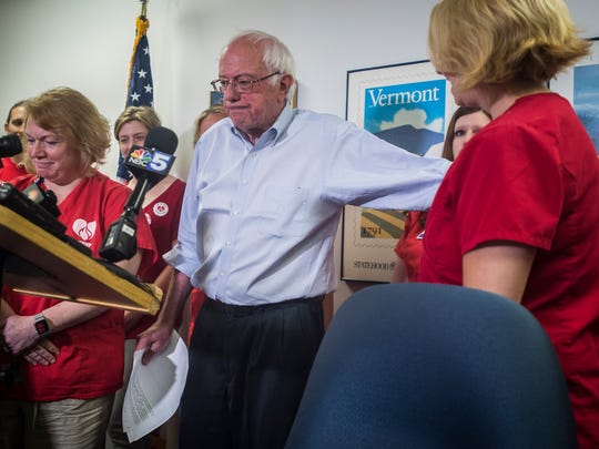 Sen. Bernie Sanders, I-VT, joins UVM Medical Center nurses during a news conference in his Burlington office on Friday, July 7, 2018, in support of the nurses union which is negotiating with the hospital. The union voted to strike next week if they cannot come to an agreement over pay, staffing and other issues.