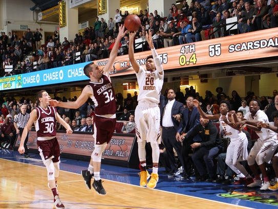 Mount Vernon's Jason Douglas-Stanley hoists a shot in front of a packed crowd at the County Center during the 2017 Class AA championship game.