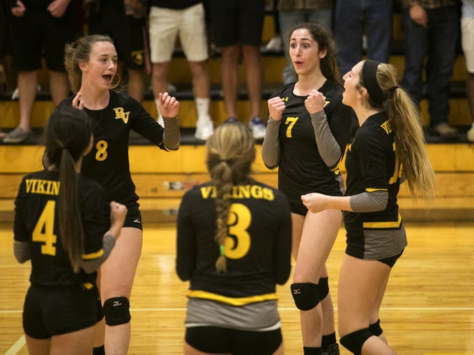 Bishop Verot celebrates a point in the second set against