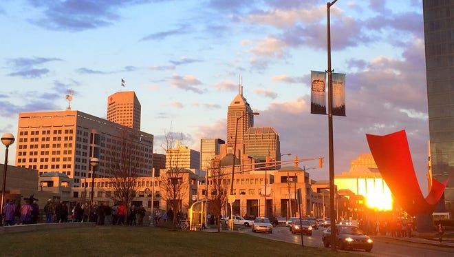 A sunset is reflected off Downtown Indianapolis buildings in April 2015.